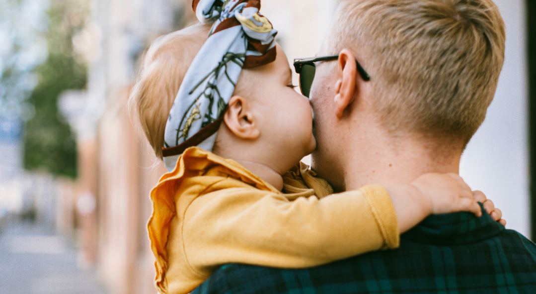 Son kissing Father