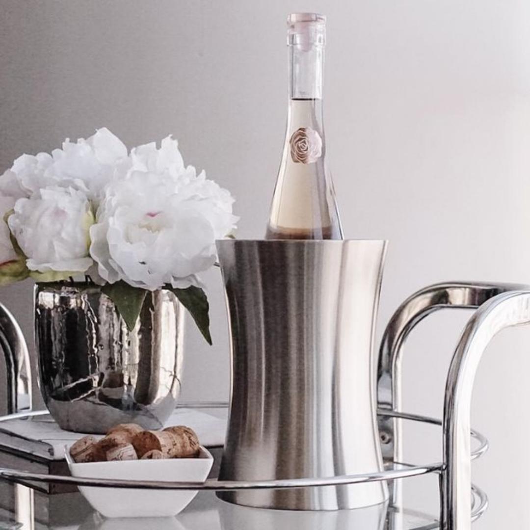 Silver sleek wine cooler on a bar tray.