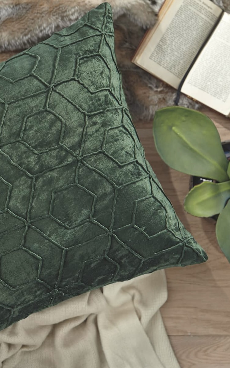 Emerald green throw pillow from Ashley Homestore