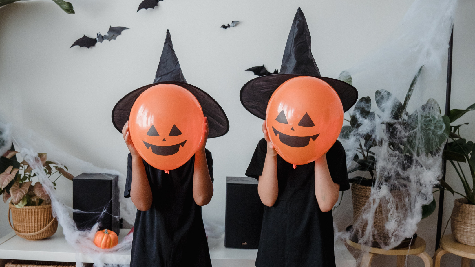 Halloween Witch Costumes with pumpkin masks.