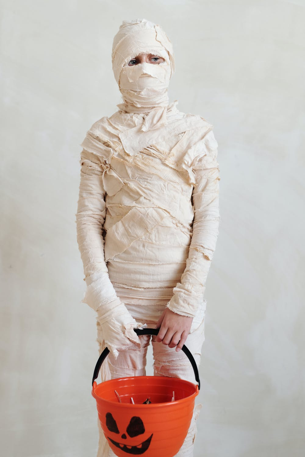 kid dressed up as a mummy